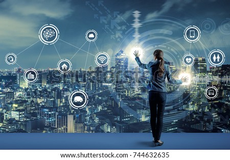 young business person and graphical user interface concept. Artificial Intelligence.  Internet of Things. Information Communication Technology. Smart City. digital transformation. #744632635
