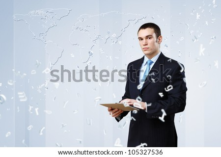 Young business person working with a notebook