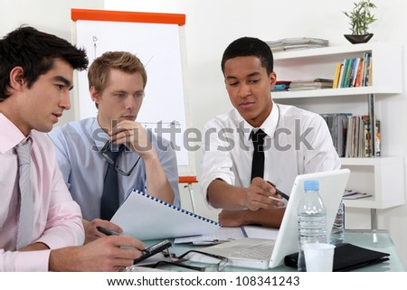Young business professional discussing the results of a report