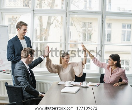 Young business team doing high five at conference table #197189672