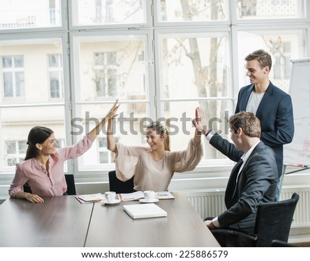 Young business team doing high five at conference table #225886579
