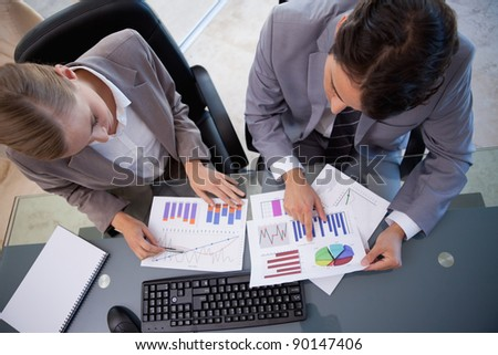 Young business team looking at statistics in a meeting room