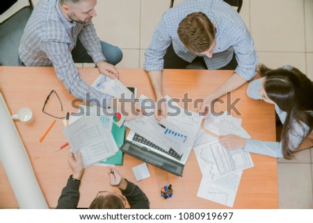 young business team working in office top view #1080919697