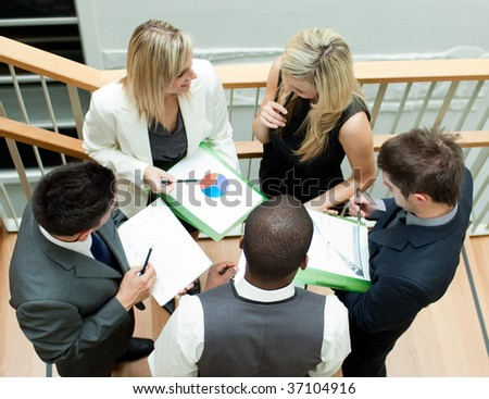 Young business team working on stairs