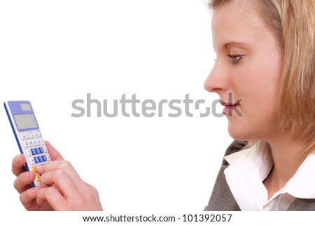 Young business woman calculates on a calculator