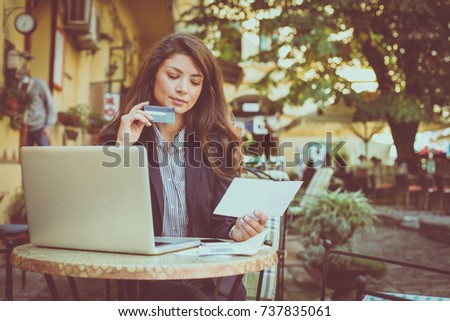 Young business woman check credit card count on laptop.
