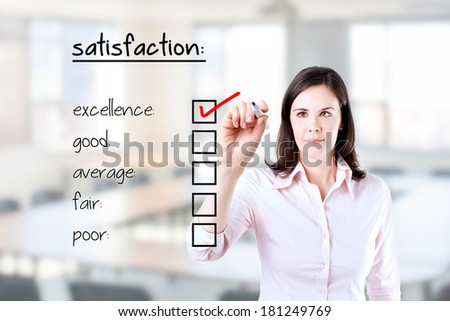 Young business woman checking excellence on customer satisfaction survey form. Office background.