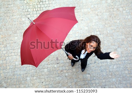 Young business woman checking if it's raining