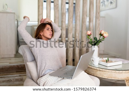 Young business woman doing exercises to relieve tired of computer eyes, stretching arms to relax muscles, reduce tension, improve vision, yoga and relaxation at work