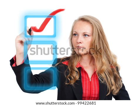 Young business woman drawing a virtual check mark on a virtual monitor