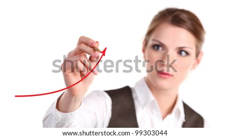 Young business woman drawing an arrow with red pencil