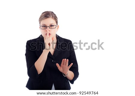 Young business woman gesturing silence sign, isolated on white background.