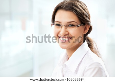 Young business woman giving you attractive smile