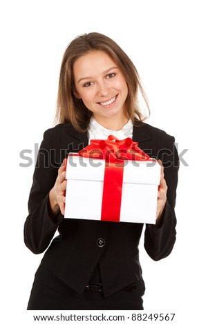 Young business woman happy smile hold gift box in hands. Isolated over white background