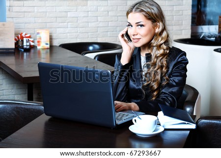 Young business woman having a break at a caf