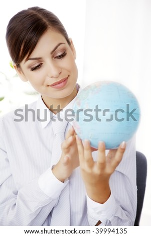 young business woman holding and looking a globe