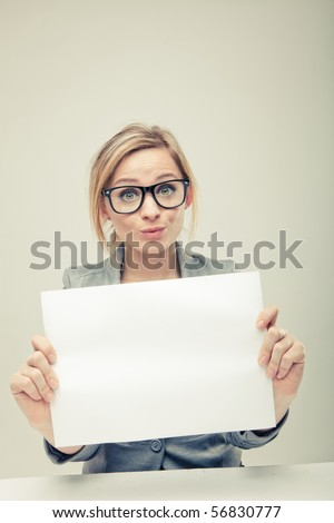 young business woman holding empty white board
