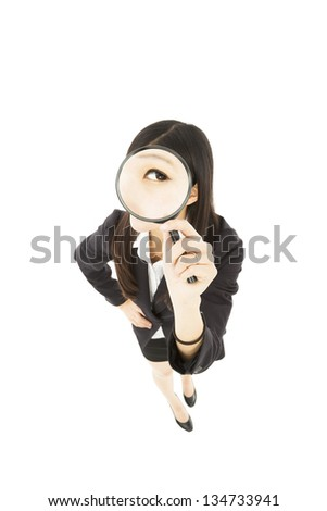 Young business Woman holding Magnifying Glass