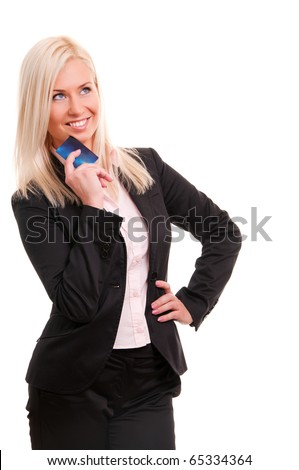 Young business woman holding new credit card