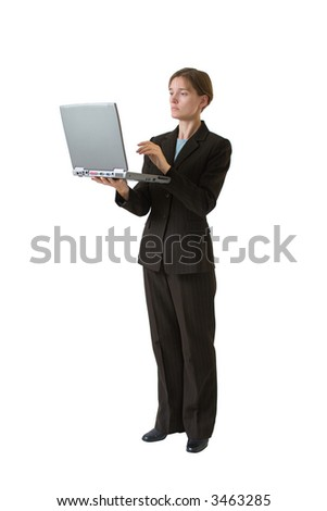 Young business woman in a tailored suit working with a laptop computer. Image is isolated on a white background.
