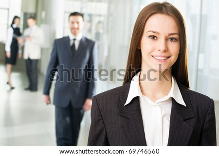 Young business woman in an office environment