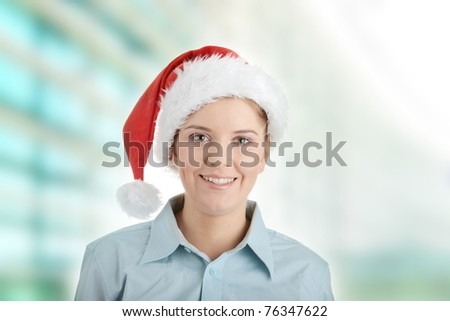 Young business woman in santa hat - stock photo