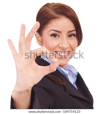 Young business woman indicating ok sign. Isolated over white background