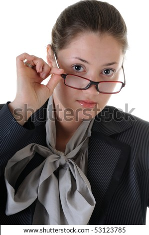 Young business woman is serious looking above glasses. Isolated on white background.