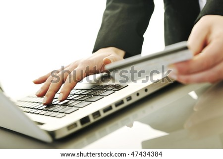 young business woman making online payment with credit card and representing concept of new age in banking and plastic money