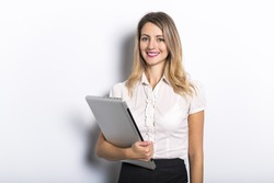 Young business woman offers computer product, on grey background