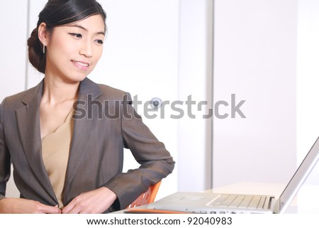 Young business woman on a laptop at her office