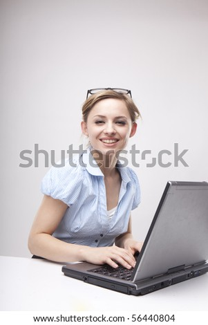 Young business woman on a laptop wearing casual