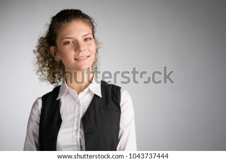 Young business woman on gray background #1043737444