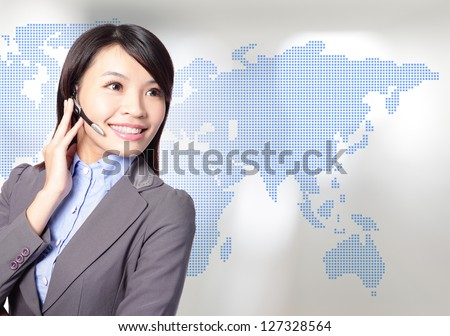 Young business woman operator in headset smile face with asia map background, asian beauty model