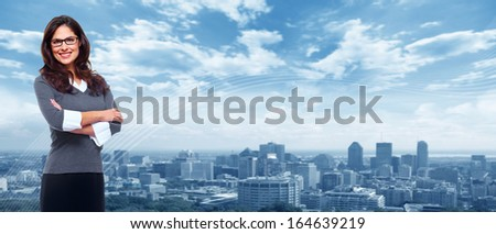 Young Business woman over urban blue background.