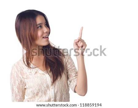 Young business woman pointing to copy  space on white background