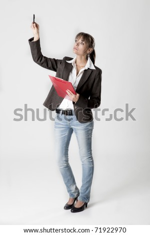 Young business woman points with her finger and counts