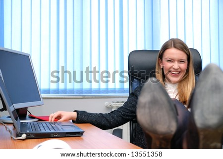 young business woman relaxing with feet on table