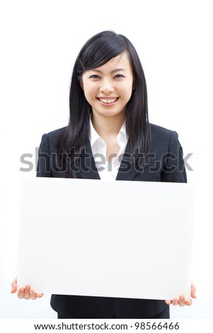 Young business woman showing billboard, isolated on white background