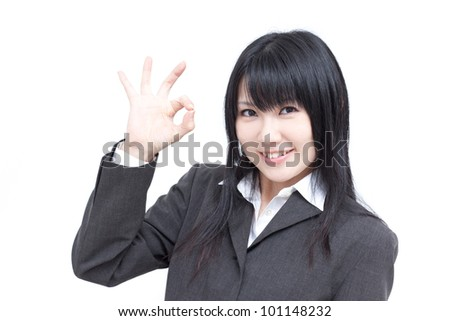 young business woman showing OK sign, isolated on white background
