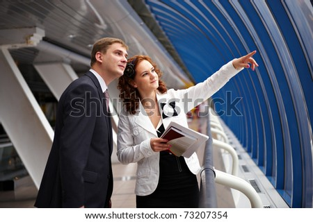 Young business woman shows her partner promising place for the construction of the facility