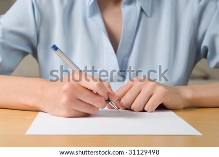 Young business woman signing a documen