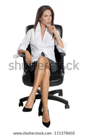 Young business woman sitting on chair against white background