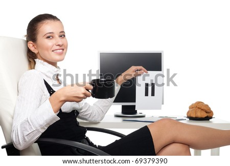 Young business woman sitting on chair at the desk in office drink coffee and hold pause sigh