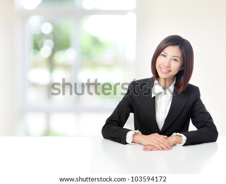 Young Business woman smile face close up and sit at company office with white table, window outside are green background, model is a asian beauty