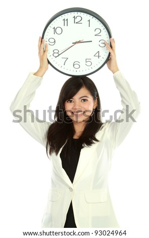 young business woman smiling holding a big clock