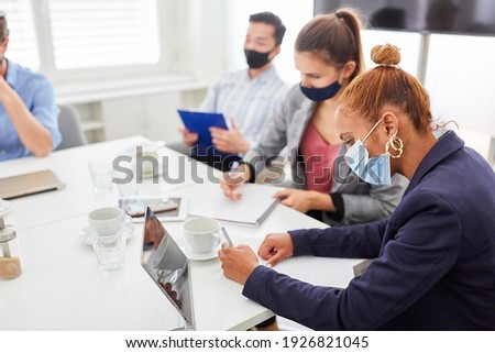 Young business woman takes notes in a workshop or seminar