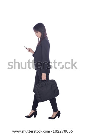 young business woman talking on the phone and holding a brief case while walking on white background