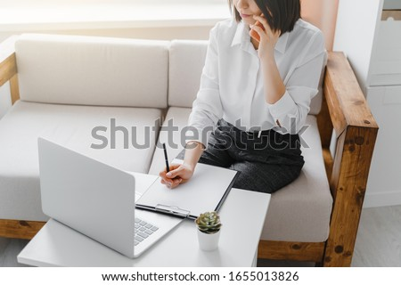 Young business-woman talking on the phone in office. Business concept.