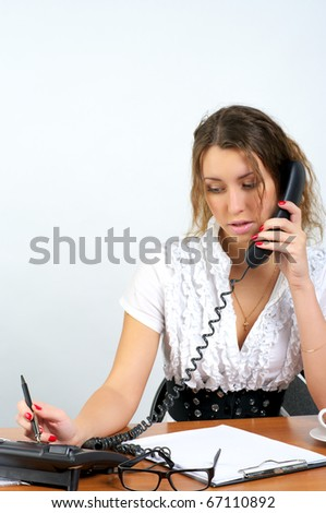 Young business woman talking phone